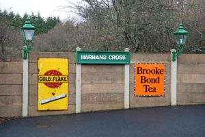 Retro advertisements and signage at Harman's Cross station