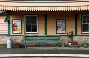 Vintage posters and railway items on Harman's Cross station platform