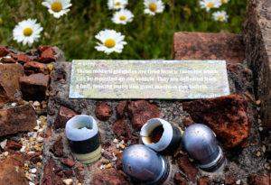 WWII grenades set into wall in Tyneham village