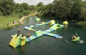 People on the inflatable course at Dorset Adventure Park
