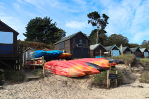 Fore/Adventure hut and kayaks on Studland's Middle Beach