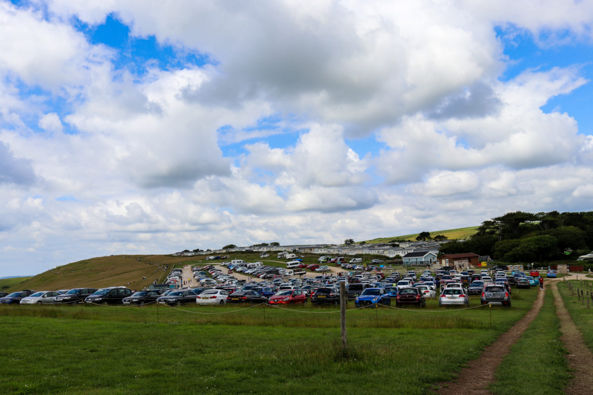Cars parked at Durdle Door, from the overflow parking section