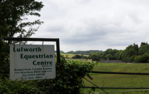 Sign for Lulworth Equestrian Centre in Combe Keynes