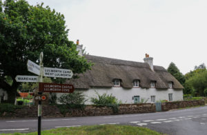 Signage in front of thatched cottage in East Lulworth village