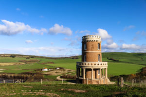 Clavell Tower with farmland and blue sky behind