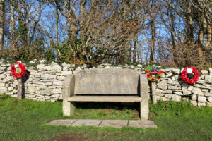 Aircraft disaster Remembrance bench with poppy wreaths on path to Swyre Head