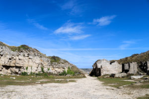 Rocky cliff and ruined quarry building at Winspit