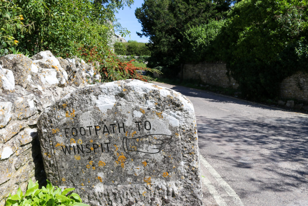 Footpath to Winspit stone sign in Worth Matravers
