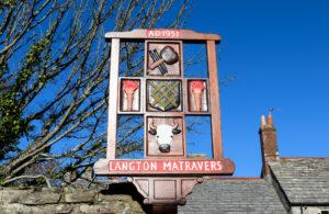 Langton Matravers village sign depicting bull and shield