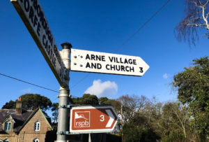 Sign for Arne village and church at the Ridge crossroad