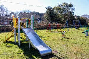 Slide and swings in the playground at Studland