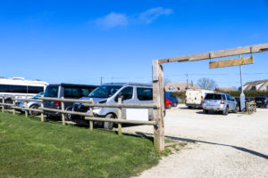 Cars in the village car park at Worth Matravers