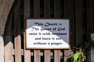 Sign on the door of St Nicholas' Church in Arne