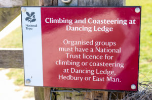 Dancing Ledge climbing and coasteering National Trust licence sign