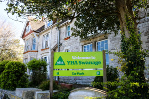 Welcome sign outside the Swanage Youth Hostel Association building
