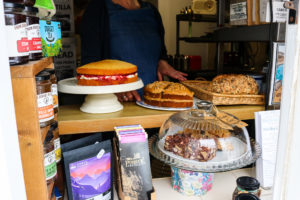 Cakes on display at the hatch of Worth Matravers Tea Room