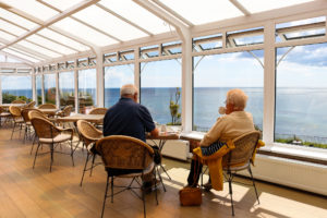 Couple having coffee in the conservatory of The Grand Hotel, Swanage