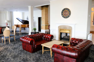 Leather sofas and grand piano in the lounge, Grand Hotel, Swanage