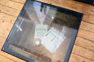 Swanage Pier café exhibition piece in floor