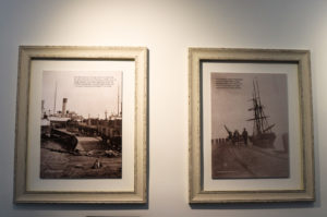 Historic pier pictures framed on wall of Swanage Pier café
