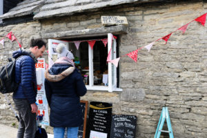 Couple looking at menu boards outside Worth Tea Room