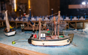 Miniature model fishing boat, part of a display at Swanage Pier