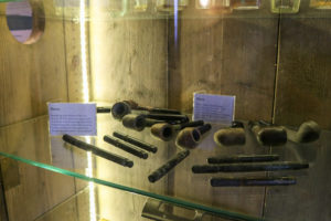 Salvaged clay pipes and pens, Swanage Pier exhibition