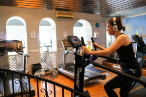 Woman on exercise bike at the Grand Hotel