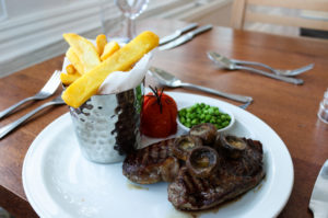 Mushrooms on rib-eye steak with chips on the side, at the Grand Hotel, Swanage
