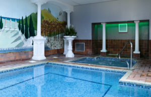 Jacuzzi next to small swimming pool at Swanage Grand Hotel
