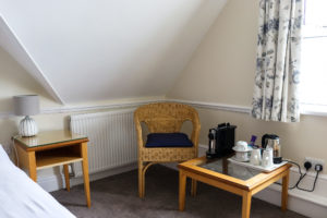 Chair and hot drink-making facilities in a room of the Swanage Grand Hotel
