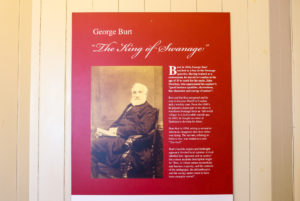 Information board about George Burt on wall of Durlston Castle's café