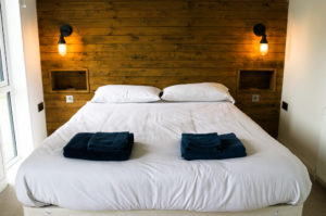 Folded towels on bed in holiday home at Swanage Coastal Park