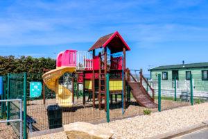 Children's climbing frame and slide at Swanage Coastal Park