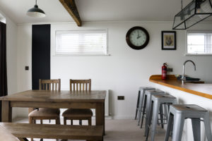 Dining area in one of the holiday lodges at Swanage Coastal Park