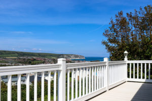 Decking and railing of a Swanage Coastal Park holiday home balcony