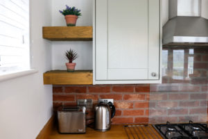 Toaster, kettle and welcoming plants in holiday home at Swanage Coastal Park