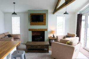 Comfortable living room chairs and coffee table at Swanage Coastal Park