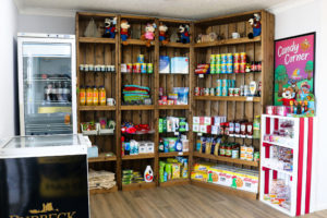 The Reception area of Swanage Coastal Park with essential items for sale