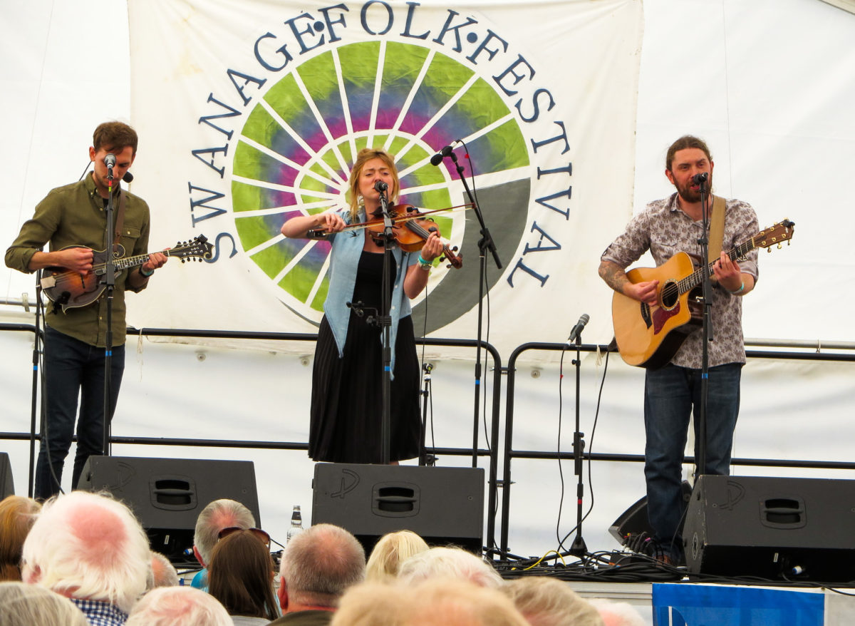 Folk group on stage at the Swanage Folk Festival