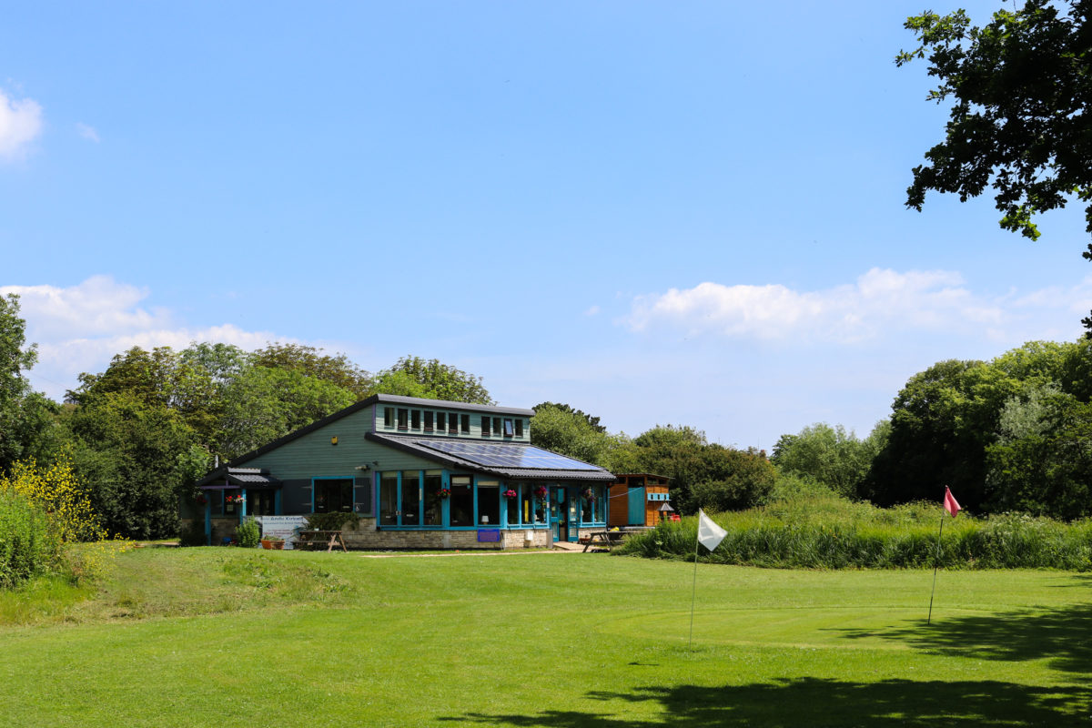 Greens in front of the Reception building at Swanage Golf Games