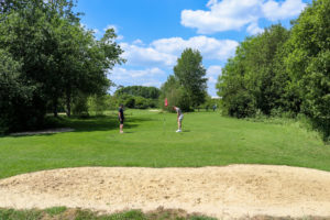 Two men playing pitch and putt at Swanage Golf Games