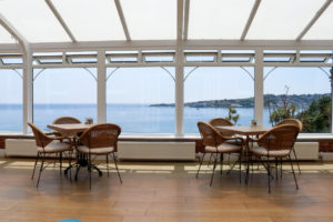 The sea of Swanage Bay seen through the Grand Hotel's conservatory window