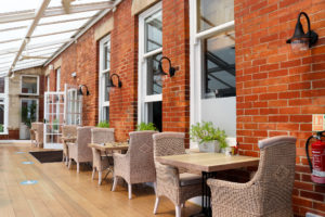Rattan chairs in conservatory of the Swanage Grand Hotel
