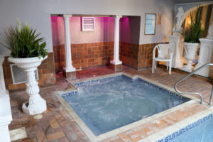 Mood lighting and plants around the Jacuzzi at Swanage Grand Hotel