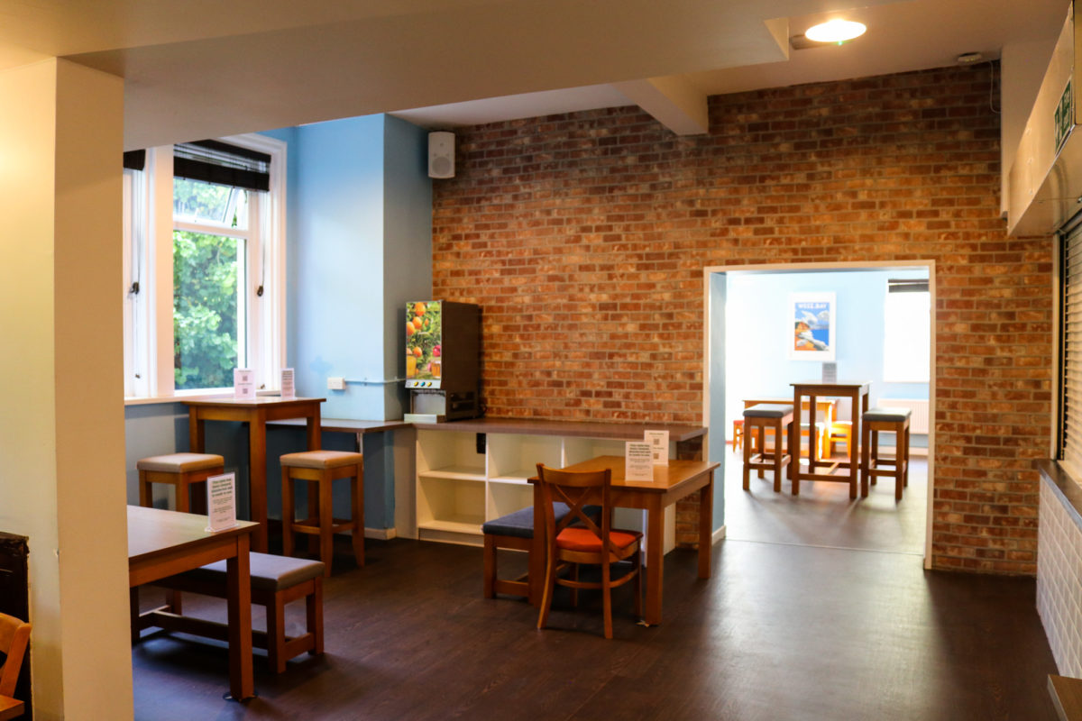 Tables and chairs in the dining area of Swanage Hostel
