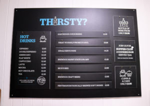 Hot & cold drinks menu board at Swanage Hostel