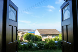 Ballard Down and sea view from the open doors of Swanage youth hostel