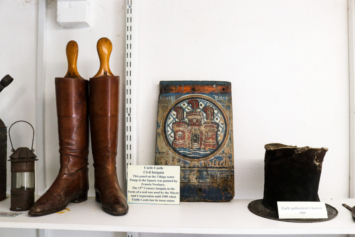 Early policeman's hat and Corfe Castle civil insignia in the village museum