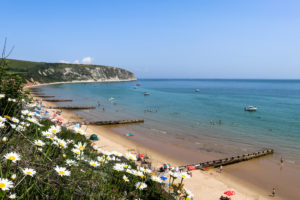 Holidaymakers on the beach below the Grand Hotel in Swanage